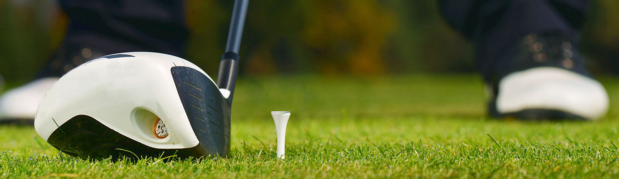 golf tee on grass