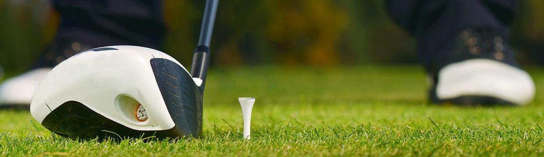 golf tee on grass